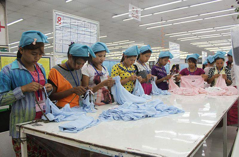 Workers at the South Bay Garment Factory in Hlinethaya Industrial Zone check quality of the factory's production that will be exported to Japan.  Photo: Aye Min Soe