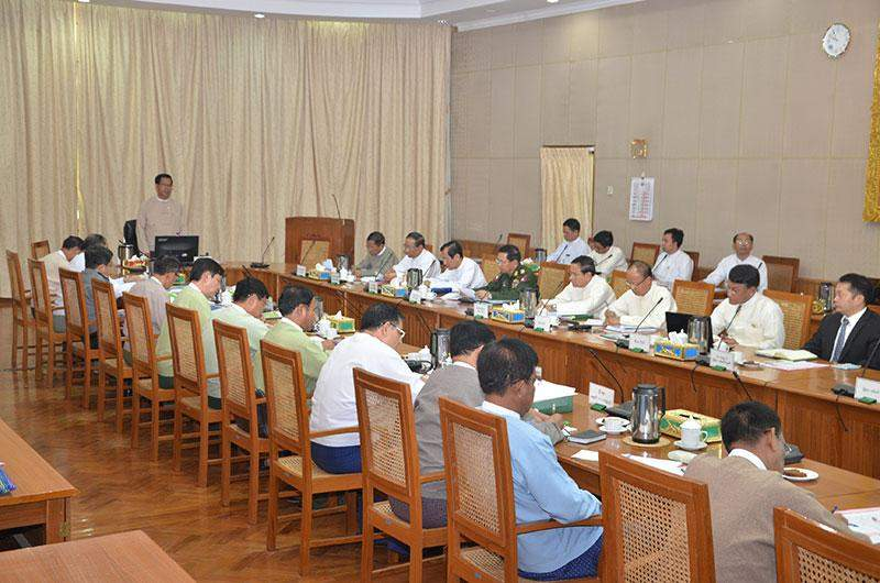 Union Minister U Hla Tun outlines implementation of investigation  commission's report.