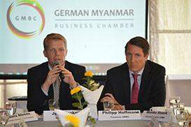 GMBC President Jens Knoke (left), seated next to GMBC Treasurer Philipp Hoffmann, makes a presentation at a press conference for the launch of the German Myanmar Business Chamber in Yangon on Friday.