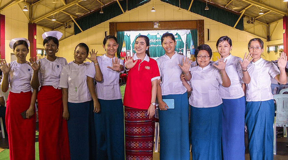Soap brand ambassador Chit Thu Wai poses for documentary photo with midwives and nurses at the International Day of the Midwife and Nurse event at Yangon's University of Nursing.— Khin Yadana