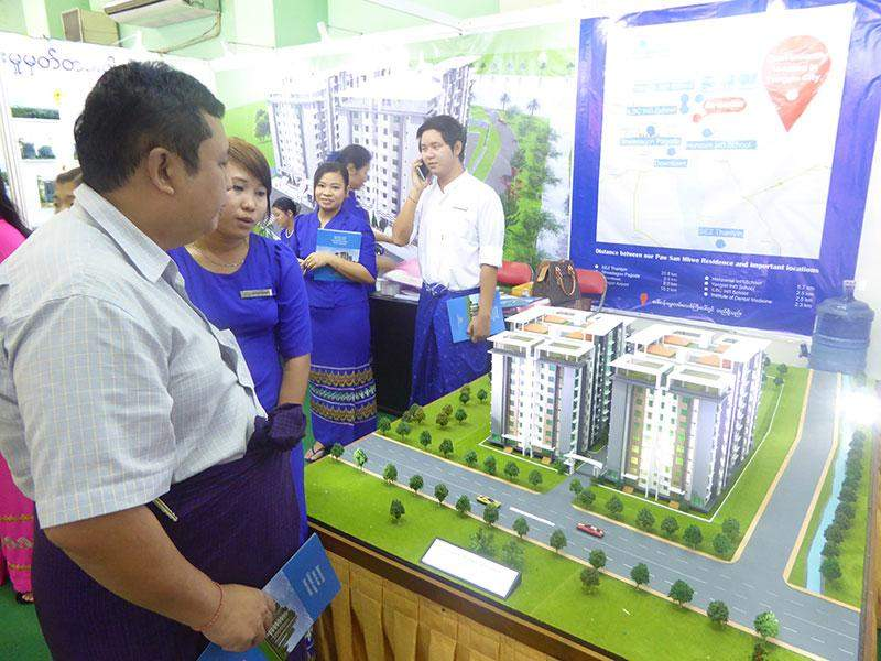 Visitors view scale model of high-rise buildings at Myanmar's biggest property expo.—Photo: Khaing Thanda Lwin