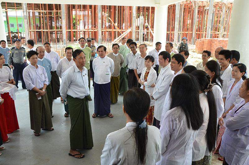 Speaker Thura U Shwe Mann converses with medical officers and staff at construction site of Kanyutkwin People's Hospital. MNA