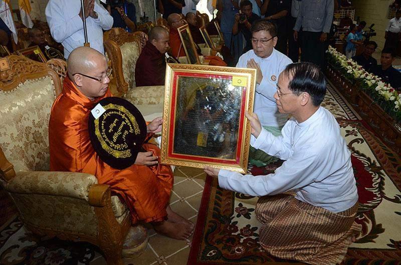 Vice President Dr Sai Mauk Kham offers  certificate to a monk.