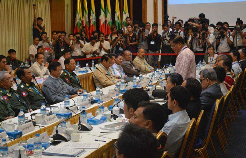Accompanied by ethnic armed group peace negotiators, NCCT leader  Nai Hong Sa addresses a nationwide ceasefire meeting with the  government's peace negotiating team at Myanmar Peace Centre in Yangon.  Photo: Ye Myint