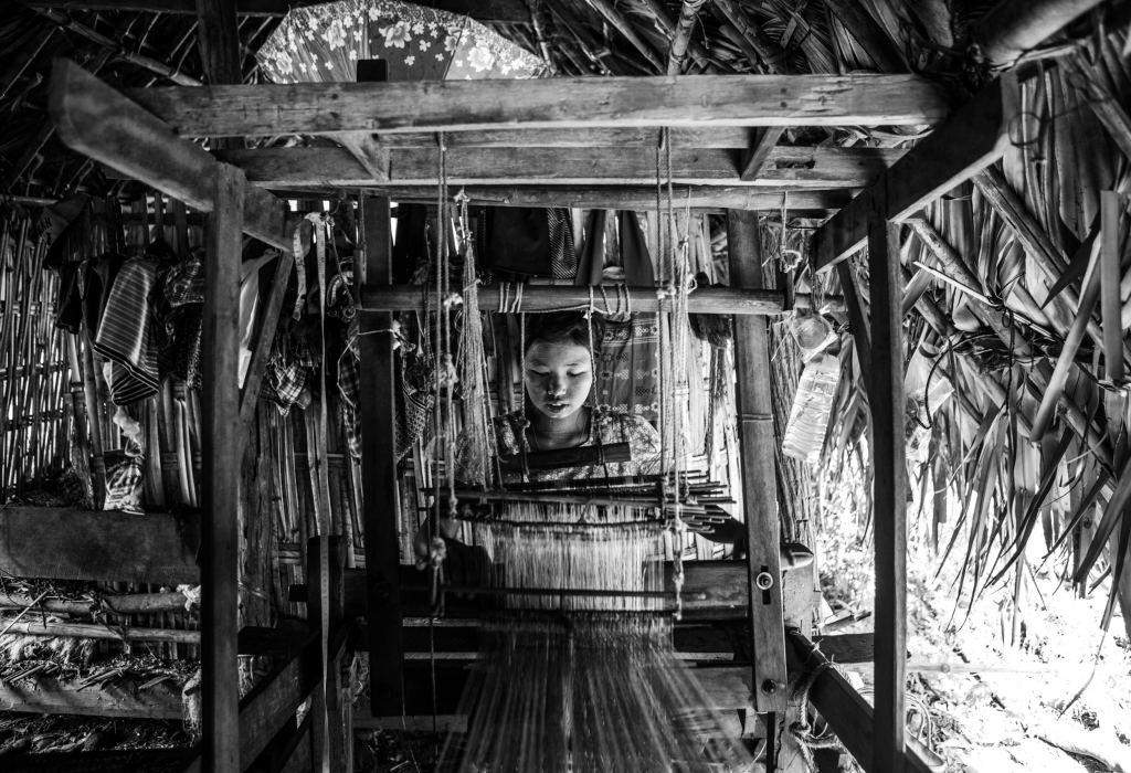 A girl works a loom in a village west of Mandalay. The girl, a Girl  Determined participant, left school to work full time to support her family. Photo: Andrew Stanbridge.