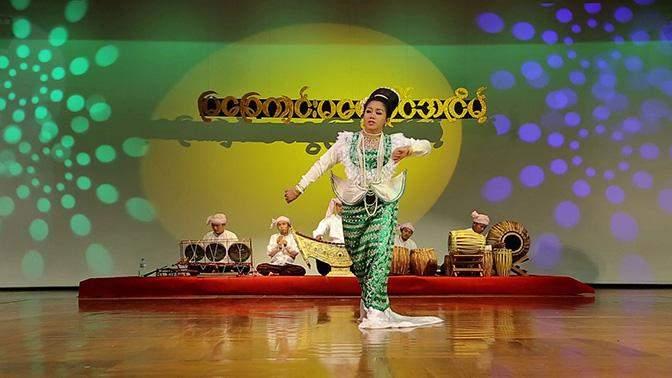 A female dancer  presents performance of Myachegyin Ma Ngwe Myaing in Anyeint dance.
