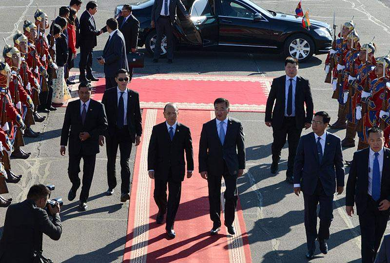 President U Thein Sein being seen off by Mongolian Minister of Foreign Affairs and officials at Chinggis Khan International Airport in Ulaanbaatar, Mongolia.—MNA