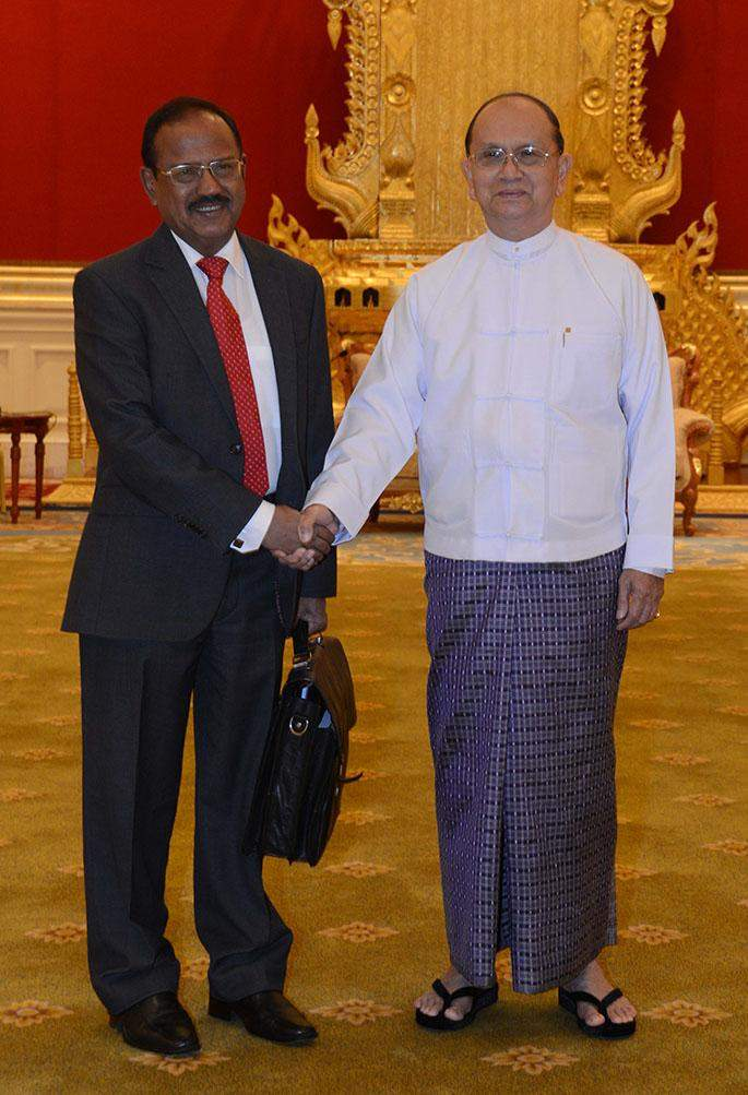 President U Thein Sein shakes hands with Mr Ajit Doval, National Security Adviser to Indian Prime Minister Narendra Modi.