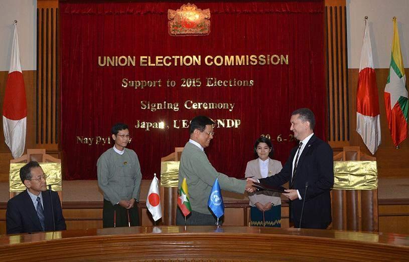 Union Election Commission Chairman U Tin Aye greets Resident Director Mr Toily Kurbanov of UN Development Program.