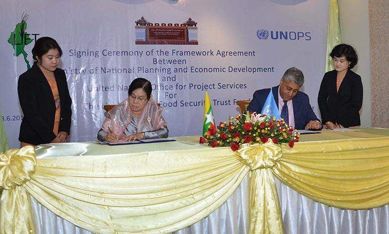 Deputy Minister Daw Lei Lei Thein and Mr. Sanjay Mathur, Director & Representative of UNOPS Myanmar sign framework agreement.