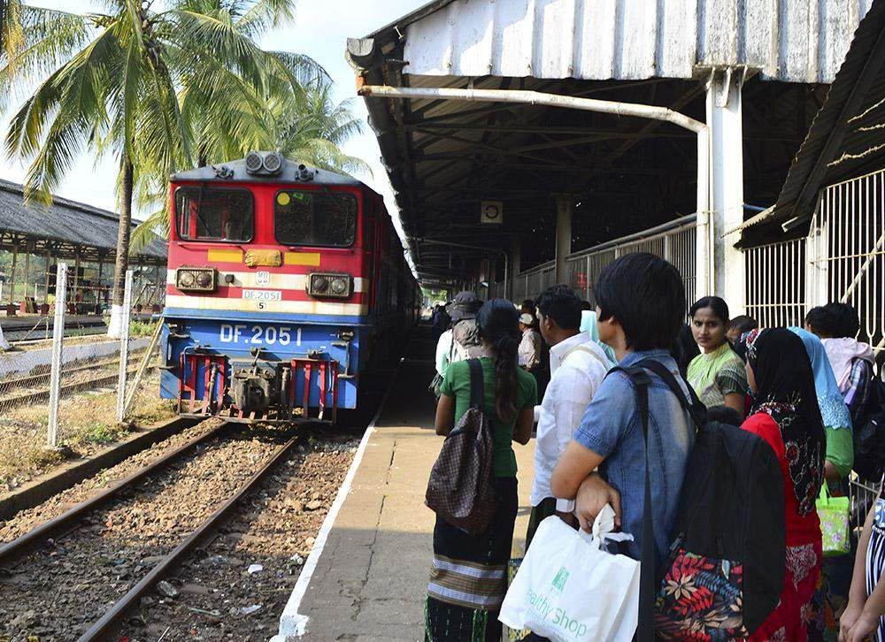 Passengers waiting to take a local train on the Yangon-Mandalay route. Photo: Aye Min Soe