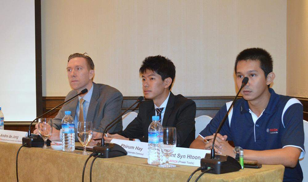 Representatives of German multinational engineering and electronics group Bosch, Mr Andre de Jong (left), Mr Phirum Hay and U Than Syn Htoon, address the media at a press conference in Yangon. Photo: Ye Myint