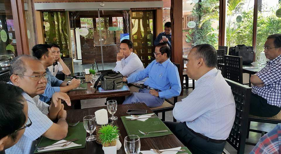 An MPC team holds discussions with ethnic peace negotiators at a restaurant in Chiang Mai, Thailand, on Thursday.