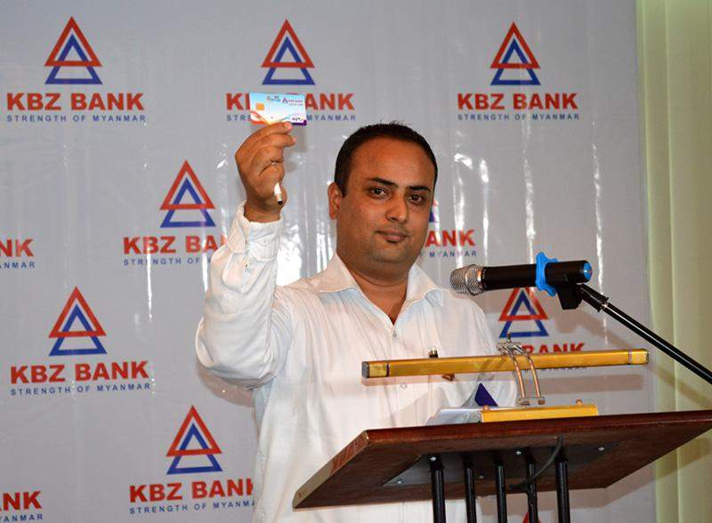 Mr Ashis Kumar Sharma, KBZ Bank's head of cards and electronic payments, displays the new KBZ Bank credit card at a press briefing  Wednesday in Yangon.— Photo: Ye Myint