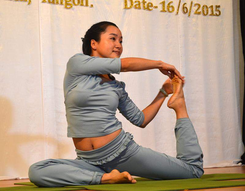 A competitor performs a yoga pose in a competition hosted by Indian Embassy in Yangon on Tuesday. Photo: Ye Myint