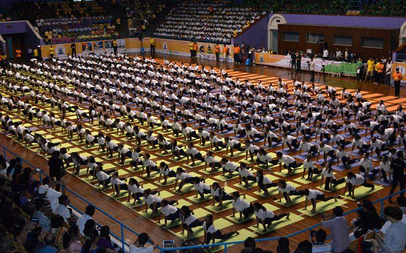 500 yoga enthusiasts perform a common yoga protocol including prescribed asanas in the presence of more than 3,000 spectators at Thuwunna National Indoor Stadium in Yangon on Sunday.  Photo: Ye Myint