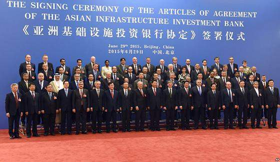 Finance ministers and delegates to signing ceremony for article of AIIB pose for documentary photo.