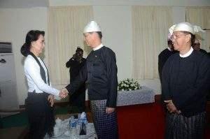 Vice President Dr Sai Mauk Kham cordially greets Daw Aung San Suu Kyi.