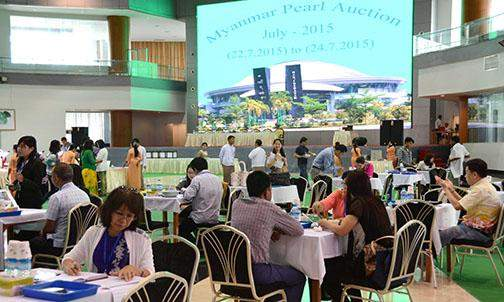 Gems merchants evaluate pearls at the Myanmar Pearl Auction.
