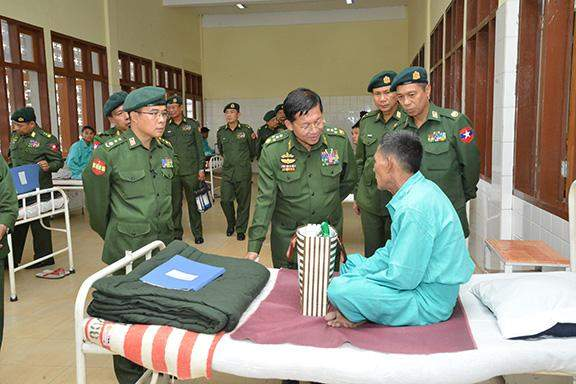 Senior General Min Aung Hlaing comforts patients at military hospital  in Kalaw.