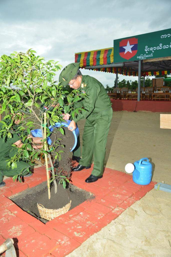 Senior General Min Aung Hlaing waters a plant at the Monsoon Tree Planting Ceremony held around Yezin dam in Zeyathiri Township.