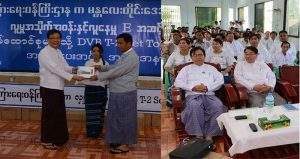 Deputy Minister for Information  U Pike Htway presents set-top boxes to Mandalay Region Minister for Finance Dr Myint Kyu.