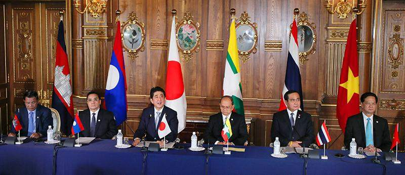 Cambodian Prime Minister Hun Sen, Lao Prime Minister Thongsing Thammavong, Japanese Prime Minister Shinzo Abe, Myanmar President U Thein Sein, Thai Prime Minister Prayut Chan-o-cha and Vietnamese Prime Minister Nguyen Tan Dung hold a joint press conference after their summit in Tokyo on July 4, 2015.