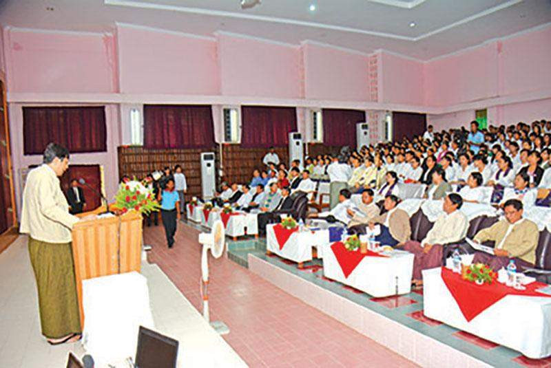 Rector Dr Myo Kywe of Yezin University of Agriculture reads out speech delivered by Union Minister for Agriculture and Irrigation U Myint Hlaing at paper-reading session.