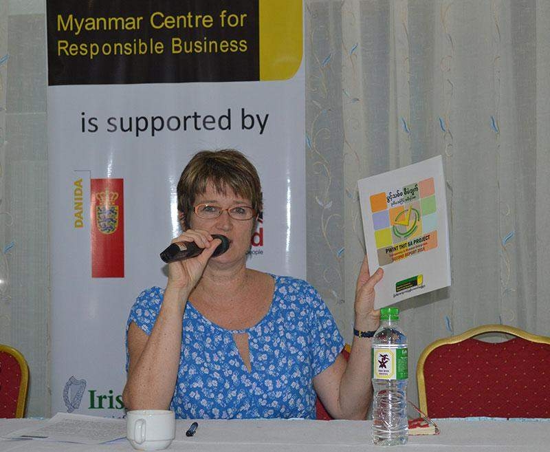Ms Vicky Bowman, director of the Myanmar Centre for Responsible Business, shows media the Pwint Thit Sa Project's second report on  transparency of Myanmar enterprises at Orchid Hotel in Yangon on Monday.— Photo: Ye Myint