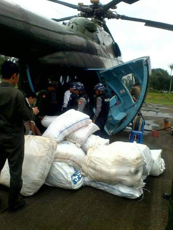 Relief aid arrives by air in An, Rakhine State, one of the four worst-hit zones.—MNA