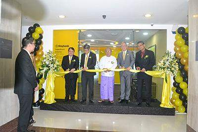 Governor of Central Bank of Myanmar U Kyaw Kyaw Maung and officials formally open  Yangon branch of Maybank.