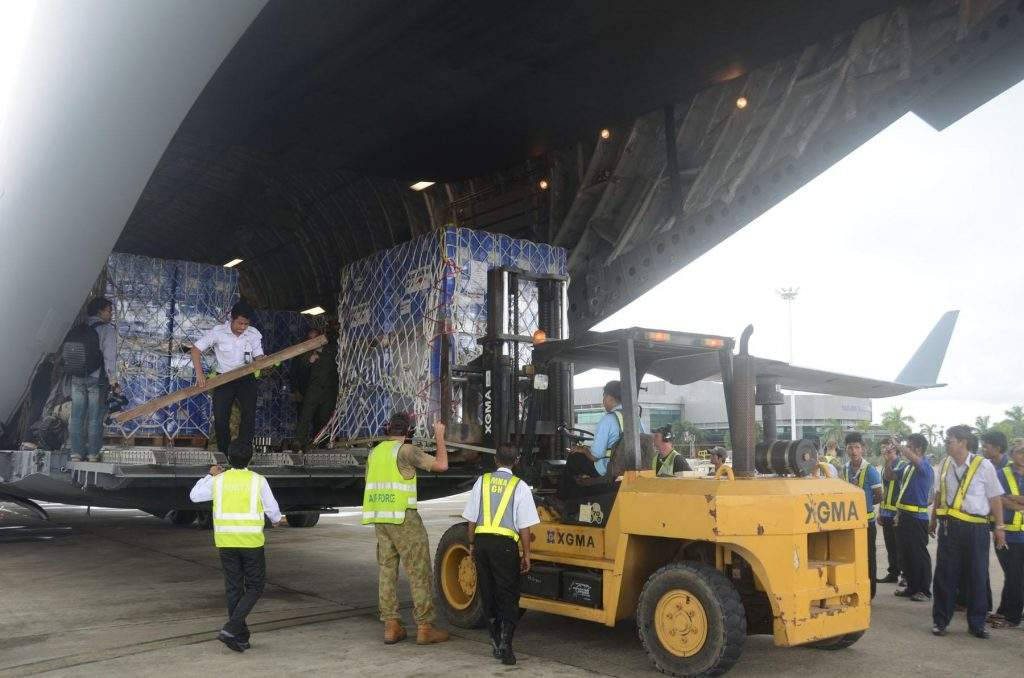 Emergency supplies  being unloaded from RAAF C17 aircraft to  distribute to flood victims. Hla Moe
