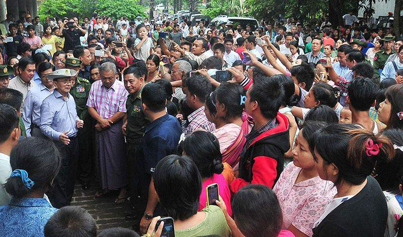 President U Thein Sein meets local people at relief camp in the precinct of Taungphila monastery in Kalay.—IPRD