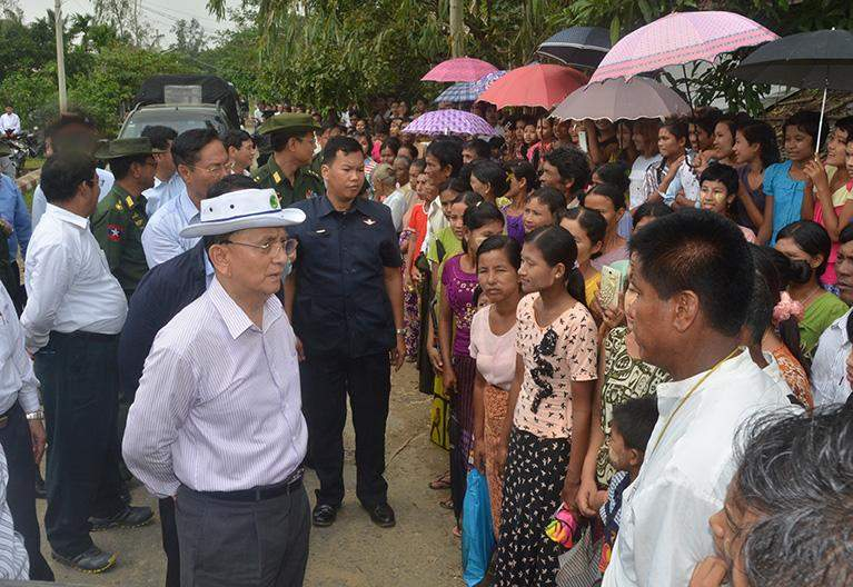 President U Thein Sein meets local residents during his visits to Yathedaung township in Rakhine State.