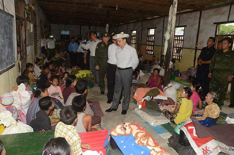 President U Thein Sein meets flood victims at relief camp in Pyay Township.—IPRD