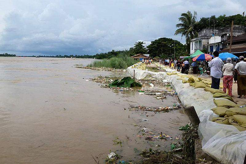 The swollen Ayeyawady River rises past its designated danger level in Nyaungdon, where residents are on alert. MOI Webportal