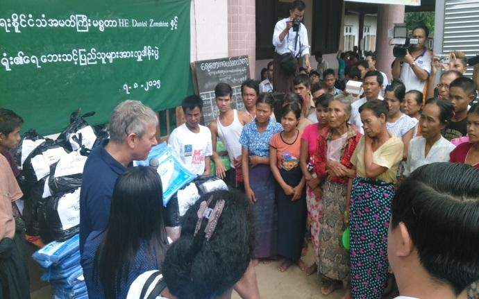 ambassador with people from the camp 1