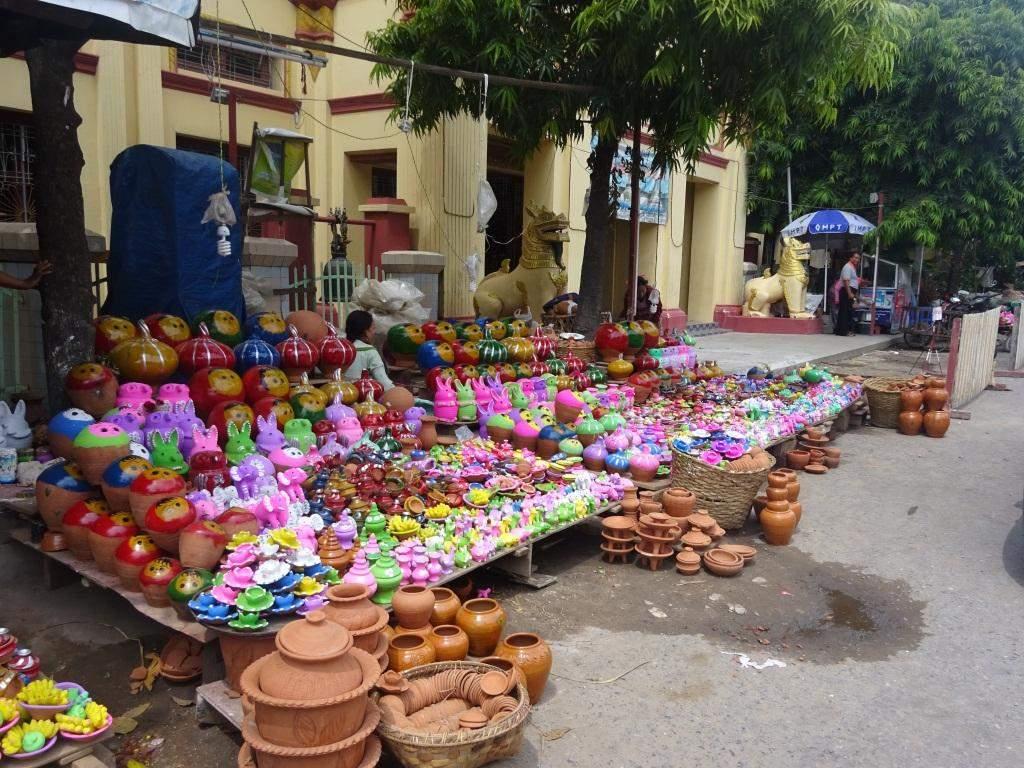 Clay toys attract Myanmar children at Phayathonsu Pagoda festival in Mandalay.