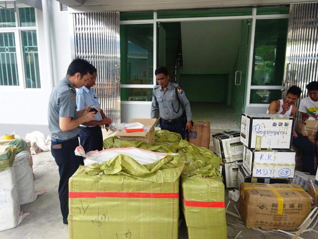 Officials confiscate unauthorized goods including mobile  phones, motorcar spare parts and accessories, and footwear worth about K 100 million. Photo: Thiha Ko Ko