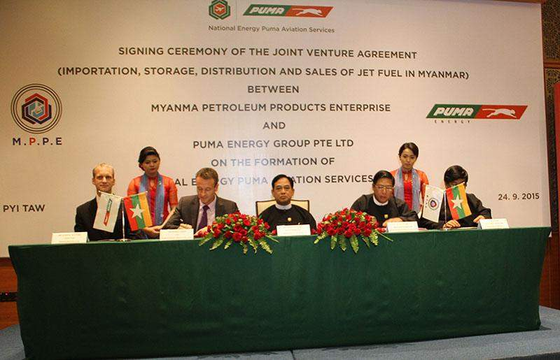 MPPE signs a joint venture agreement with Singapore-based Puma Energy Group in the presence of Union Minister for Energy U Zeya Aung. Photo: energy