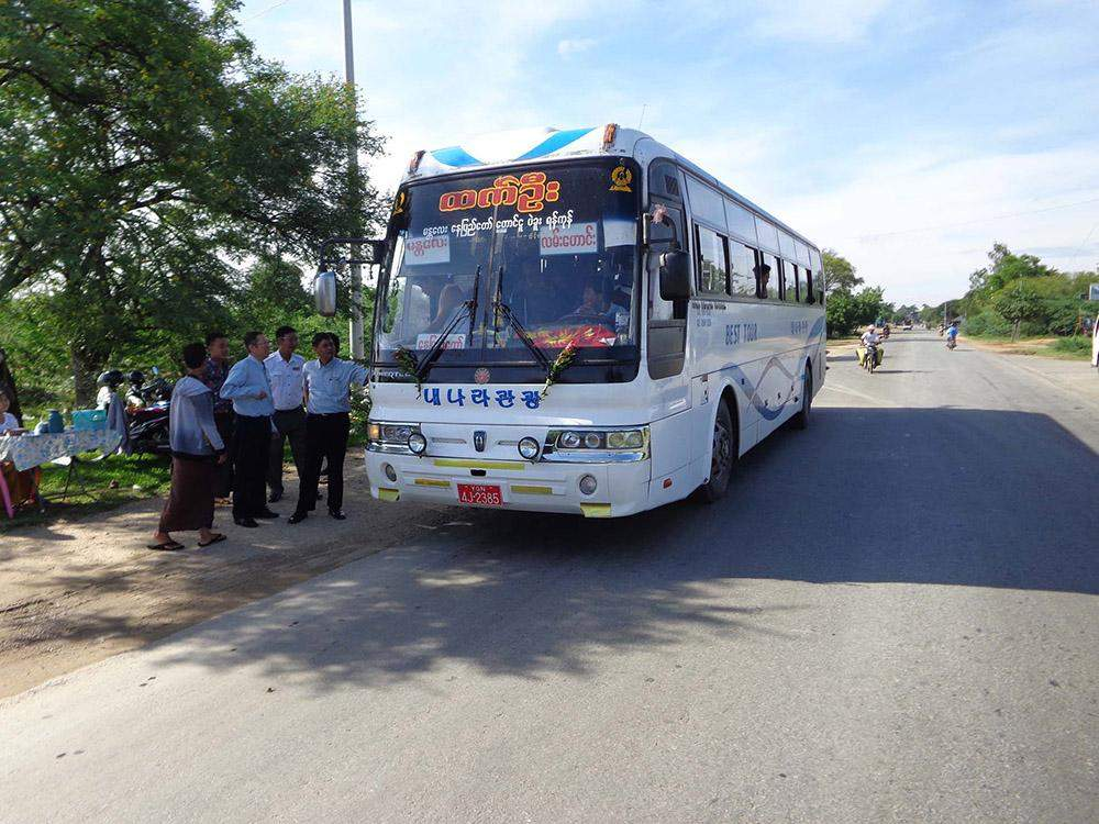 Officials check express bus for operating work with licence.