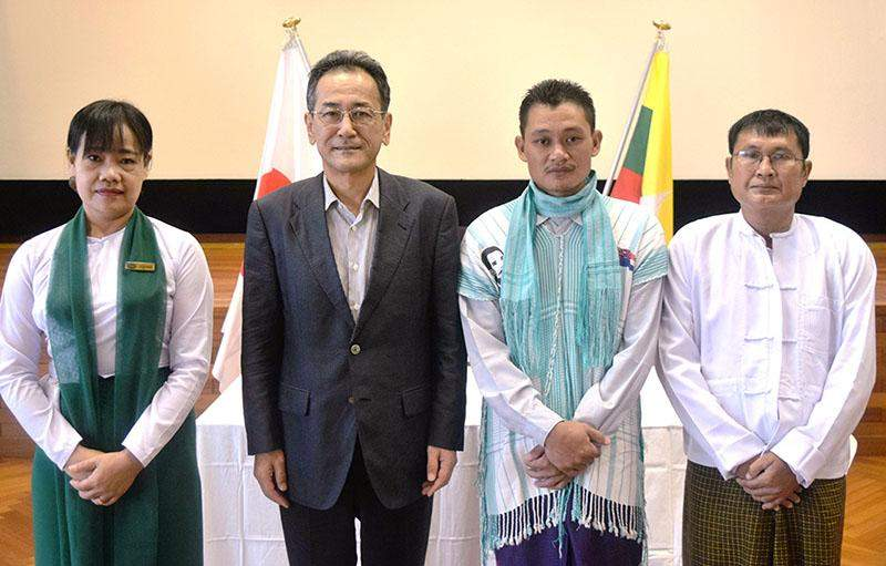 Mr. Tateshi Higuchi, Ambassador of Japan to Myanmar, seen together with the headmistress and locals after the signing ceremony. Photo: Japanese Embassy