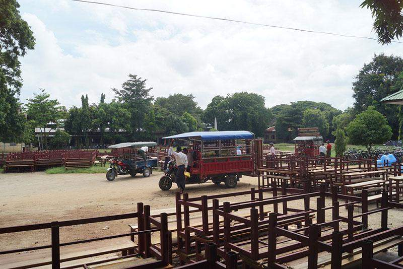 School officials bring desks donated by the President to respective schools.—Tin Soe Lwin-Tatkon IPRD