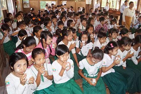 School children enjoy milk at Myaenigone basic education primary school in Myawady.