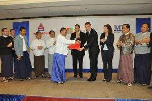 KBZ Bank Ltd Chairman U Aung Ko Win and official of Microsoft  Corporation in Yangon exchange notes. Photo: KBZ