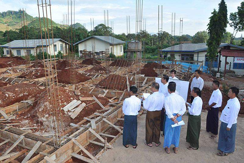 Union  Minister U Ohn Myint and party inspect construction of training facility for rural development. Photo: MNA