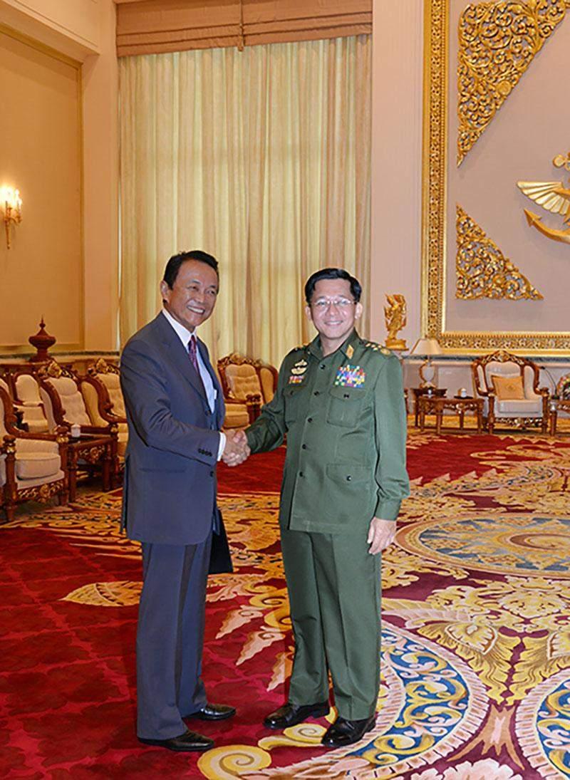 Senior General Min Aung Hlaing welcomes Japanese deputy Prime Minister Mr Taro Aso.