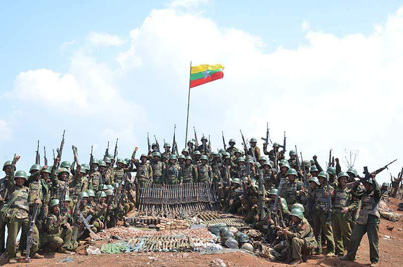 The brave soldiers on the top of the hill they retake from insurgents in Laukkai area.