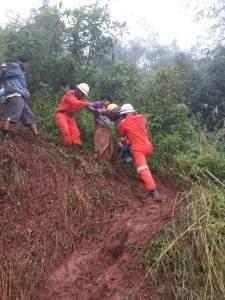Firefighters help landslide victims in village in Kayah State.