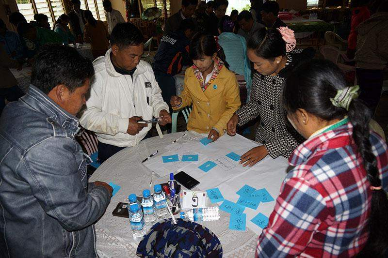 Participants discuss use of census data at the workshop. Photo: Myint Aung